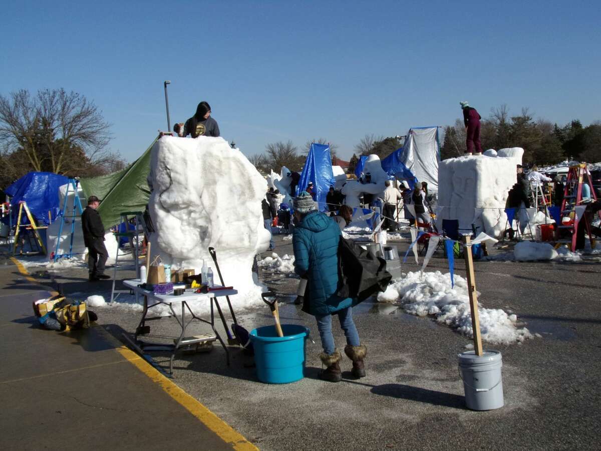 Crowds gathered to witness ice and snow sculptures being designed at last weekend's 2018 Zehnder's Snowfest.