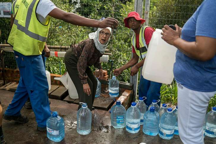 Residents collect water from a spring in the Newlands area of Cape Town, South Africa, Jan. 23, 2018. After a three-year drought, considered the worst in over a century, South African officials say Cape Town is now at serious risk of becoming one of the few major cities in the world to lose piped water to homes and most businesses. (Joao Silva/The New York Times)
