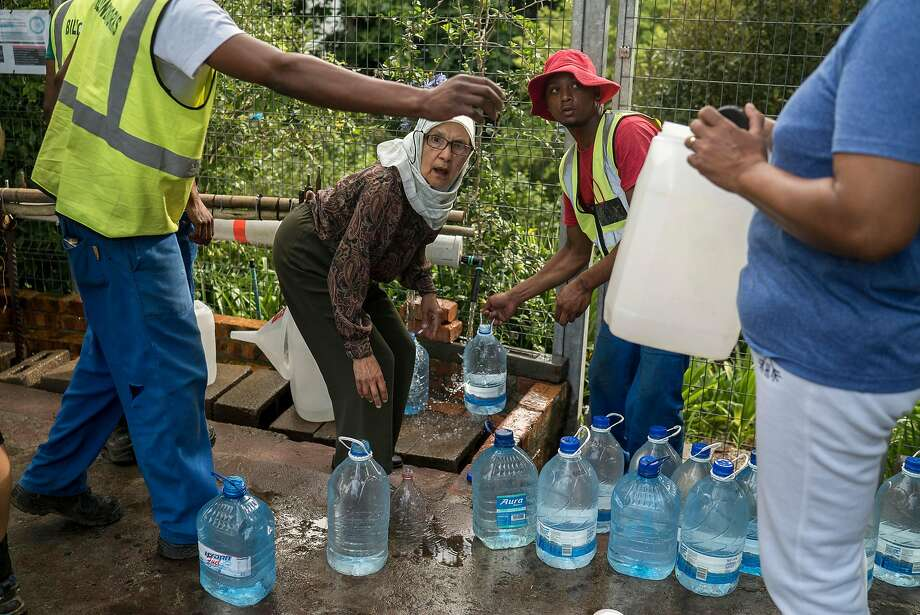 City residents collect water from a spring. A three-year drought is considered the worst in over a century. Photo: JOAO SILVA, NYT