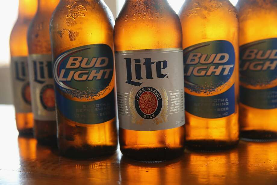 In this photo illustration, bottles of Miller Lite and Bud Light beer that are products of SABMiller and Anheuser-Busch InBev (respectively) are shown in Chicago. Illinois. Photo: Scott Olson, Getty Images