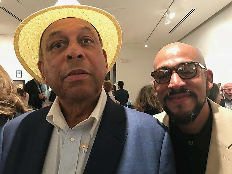 Orlando and Ali Cepeda, father and son at Caldwell Snyder Gallery Photo: Leah Garchik, San Francisco Chronicle