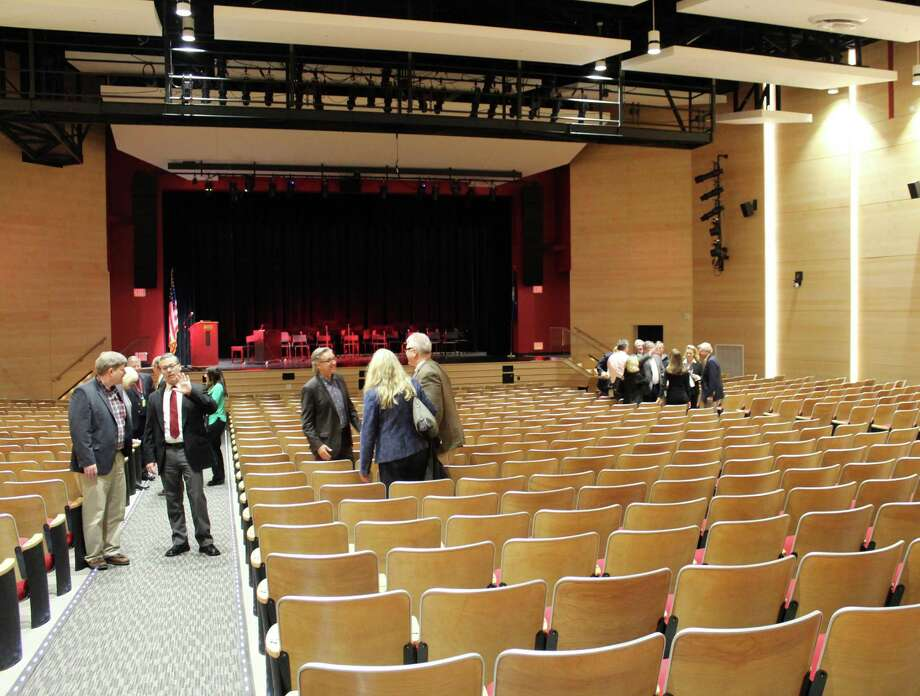 Visitors check out the newly renovated auditorium at the Saxe Middle School project grand opening on Dec. 5. Photo: Erin Kayata / Hearst Connecticut Media / New Canaan News