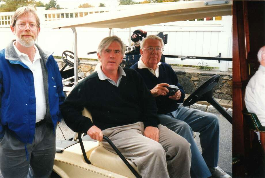 A picture from about 20 years ago of the late Mort Walker (right), who died Jan. 27, and his cartoonist sons Greg and Brian. Photo: Contributed Photo