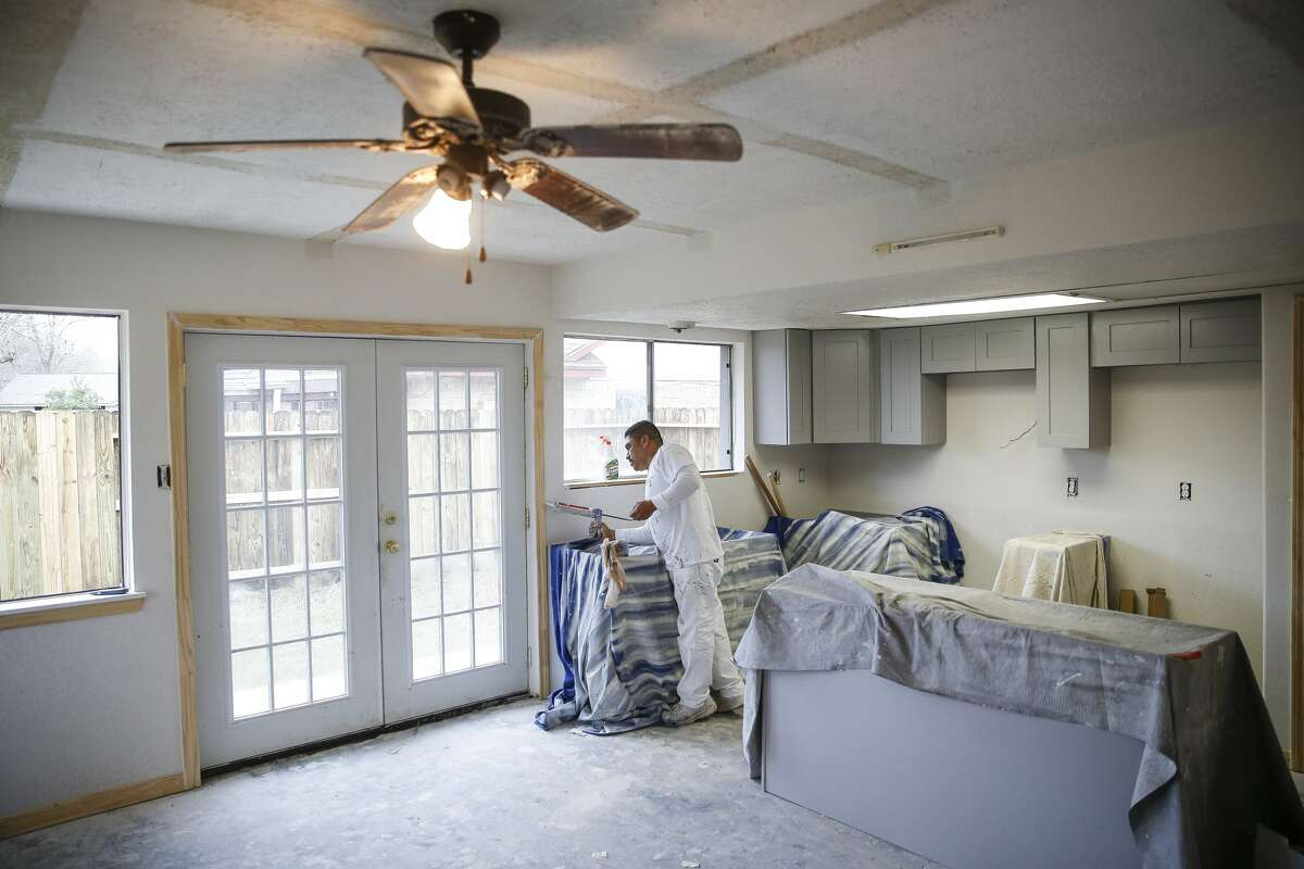 Tony's Painting owner Tony Morales repaints the repaired home of Diane and Tony Nicolas, not pictured, after it was flooded during Hurricane Harvey Thursday, Jan. 11, 2018 in Friendswood. The city of Friendswood has reverted from 2007 flood maps to 1999 maps to allow homeowners that were flooded during the hurricane to rebuild without mandating expensive home elevation requirements. ( Michael Ciaglo / Houston Chronicle)