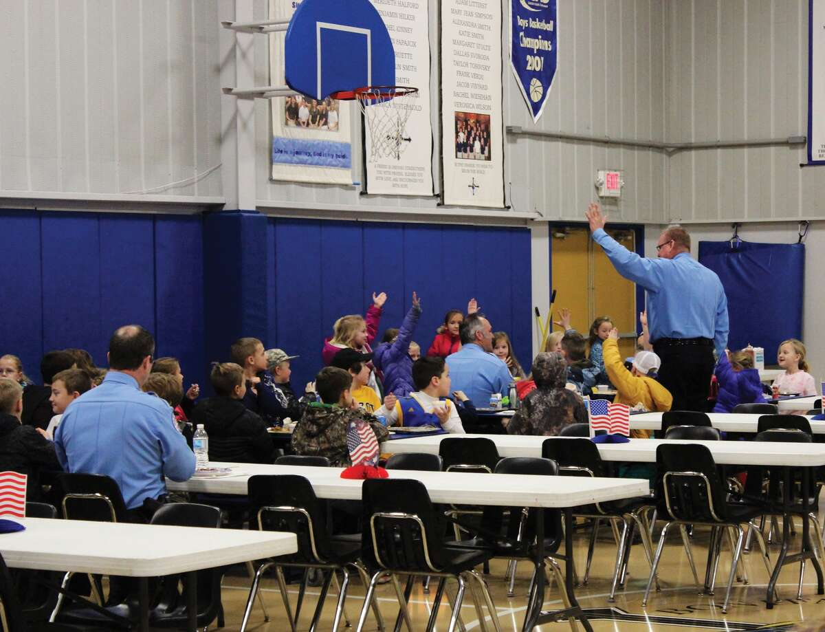 The Edwardsville Police and Fire Departments gathered for a free lunch at St. Boniface Catholic School Tuesday, Jan. 30. The school hosted the luncheon for the first responders as part of