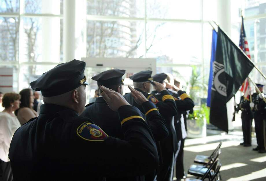 Stamford police leaders salute the flag during the playing of the National Anthem at the Stamford Police Promotion Ceremony at the Government Center in Stamford, Conn. Wednesday, Jan. 31, 2018. Police Lt. Diedrich Hohn was promoted to Captain and Sgt. Lou Derubis was Promoted to Lieutenant at Wednesday's ceremony. Photo: Tyler Sizemore / Hearst Connecticut Media / Greenwich Time