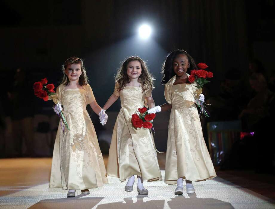 The ladies in waiting of the royal court of the Krewe of Little Rascals walk for the audience during their Mardi Gras Ball in Kenner, La., Jan. 25. The more than 200 kids riding in Sundays Mardi Gras parade participated in a glitzy ball held in their honor. Photo: Gerald Herbert /Associated Press / Copyright 2018 The Associated Press. All rights reserved.