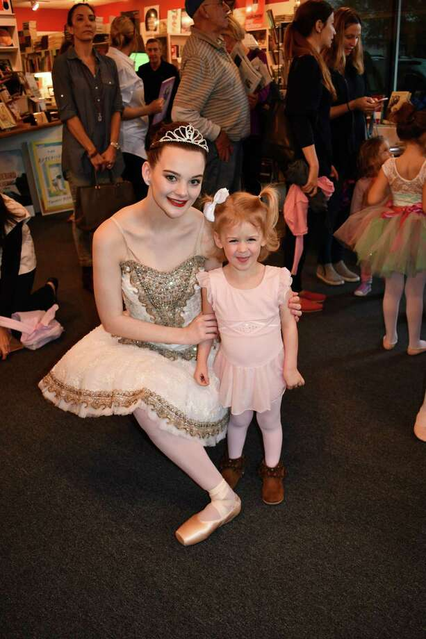 "BalletForte Co. Principal Dancer Makayla Hebert, portraying ""Aurora,"" poses with Annabelle Echols, 3, of Midtown at Brazos Bookstore, 2421 Bissonnet St., Houston, on Sunday, Jan. 21. They were participating in an event organized by River Oaks Dance, which included a reading of the new children's book, ""The Sleeping Beauty,"" based on the New York City Ballet's production, as well as a donation drive for Books Between Kids. Makayla will be appearing in BalletForte's production of ""Swan Lake"" April 7-8 at the Stafford Centre. Visit www.balletforte.org for more information. Photo: Dorothy Puch"