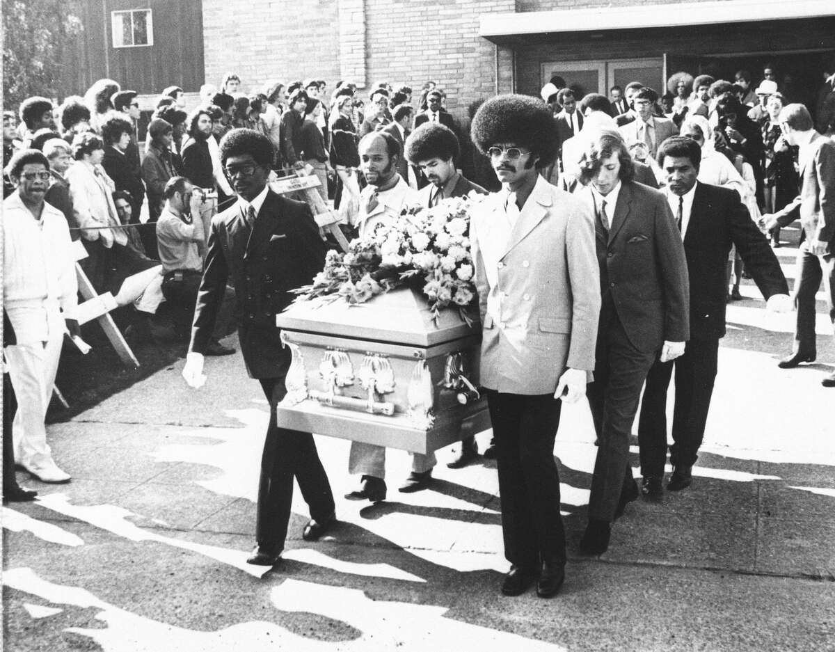 Friends of the late rock star Jimi Hendrix carry his coffin from the church after funeral services, Oct. 1, 1970 in Seattle. Pallbearers included Herbert Price, left, Hendrix's valet; Donny Howell behind Price; and Eddie Rye, front right. Others are unidentified.