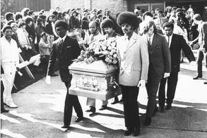 Friends of the late rock star Jimi Hendrix carry his coffin from the church after funeral services, Oct. 1, 1970 in Seattle.  Pallbearers include Herbert Price, left, Hendrix' valet; Donny Howell behind Price; and Eddie Rye, front right.  Others are unidentified.  (AP Photo/Barry Sweet)