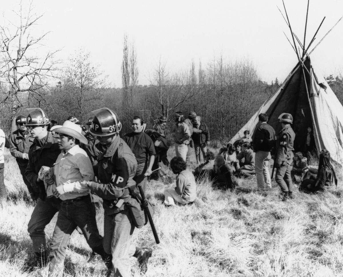 Military police marched Native American prisoners to waiting trucks after they arrested demonstrators who tried to lay claim to Ft. Lawton in Seattle on March 9, 1970. More than 70 were taken into custody and then released without charge after the group invaded the 1,100-acre army post to try to seize part of it for a Native American and Alaskan native culture center. (AP Photo)