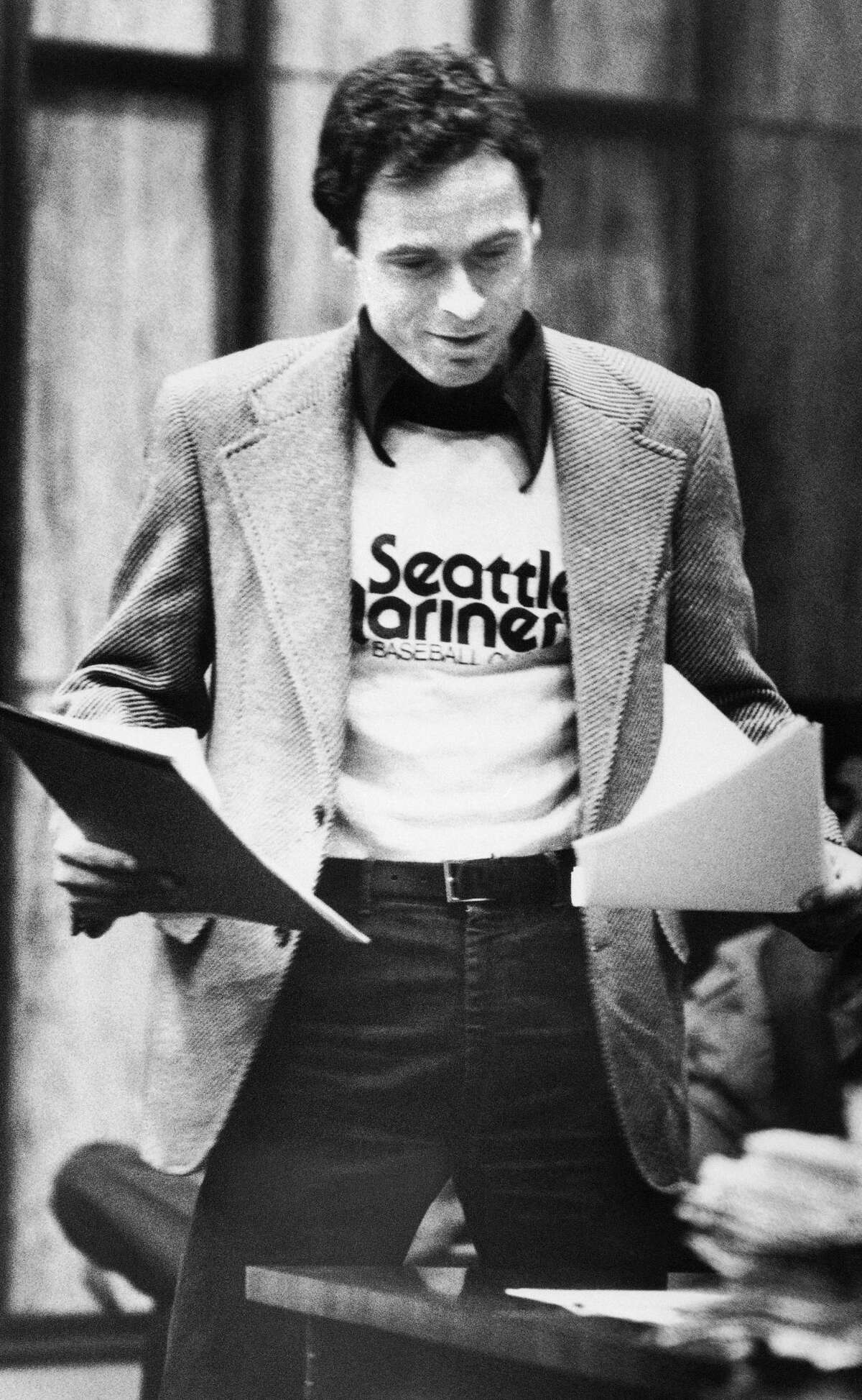 Accused serial killer Ted Bundy wears a Seattle Mariners T-shirt in court in Miami, July 5, 1979, as he presented his own motions and made a request for a typewriter in his Dade County jail cell.