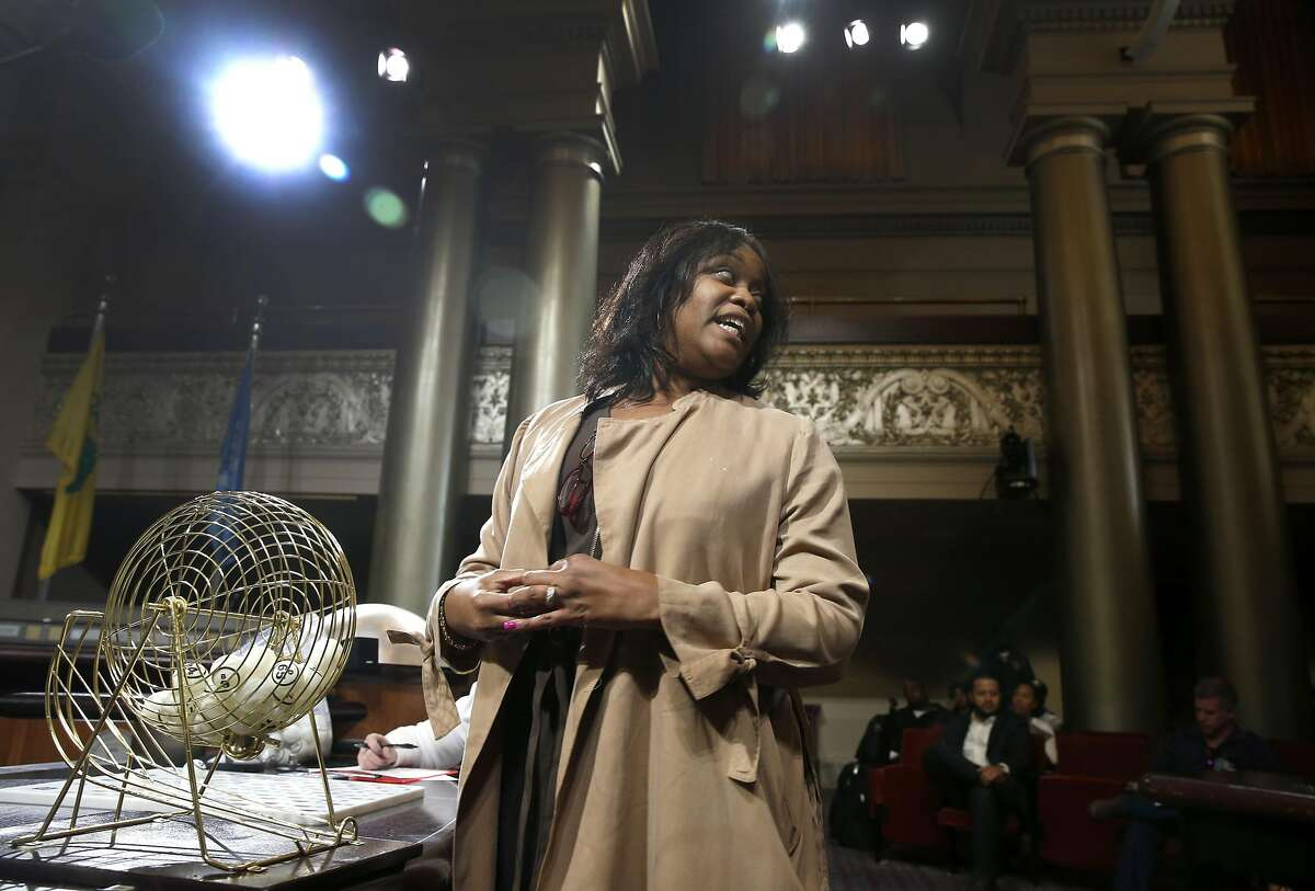 Oakland City Clerk LaTonda Simmons announces the number on a pingpong ball drawn at random. Oakland officials employed the unusual method to award four coveted cannabis dispensary permits issued by the city.