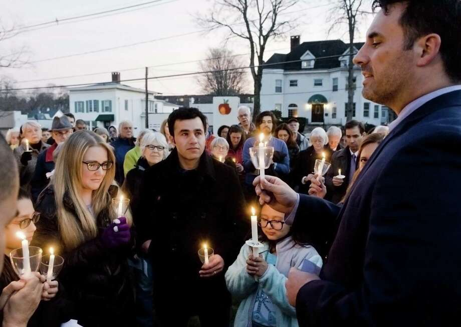 Samantha and Joel Colindres listen as Reverend Stephen Tickner gives a blessing during a candlelight vigil at Central Christian Church in Danbury for the Colindres family. Sunday, Jan. 21, 2018 Photo: Scott Mullin / For Hearst Connecticut Media / The News-Times Freelance