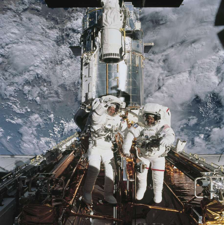 The astronauts John M, Grunsfeld and Richard Linnehan, the astronauts John Grunsfeld and Richard Linnehan near the Hubble Space Telescope, temporarily in the space shuttle Columbia's Cargo Bay, March 8, 2002. (Photo by Encyclopaedia Britannica / UIG Via Gett Photo: Encyclopaedia Britannica / UIG About Getty Images