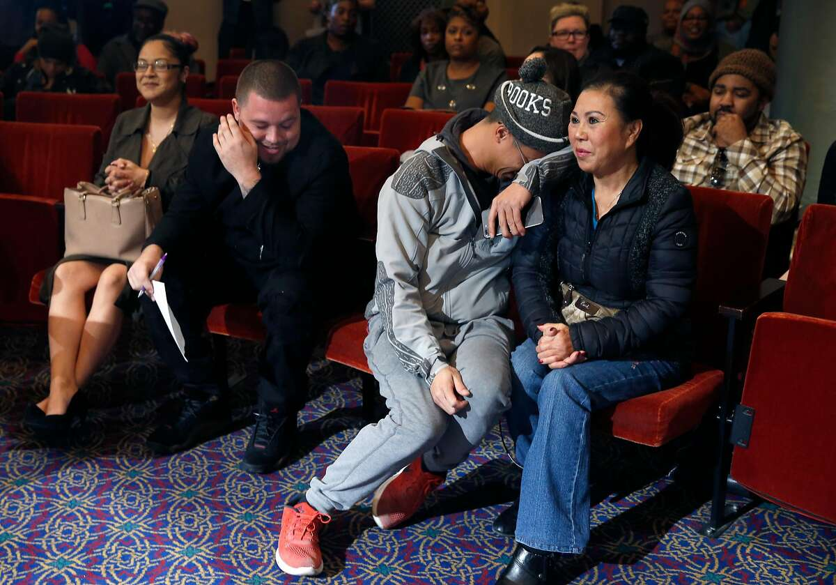 Jerry Bui (center) and his aunt, Kim Nguyen (right), react after Nguyen just misses out on a cannabis dispensary permit awarded in a random draw.