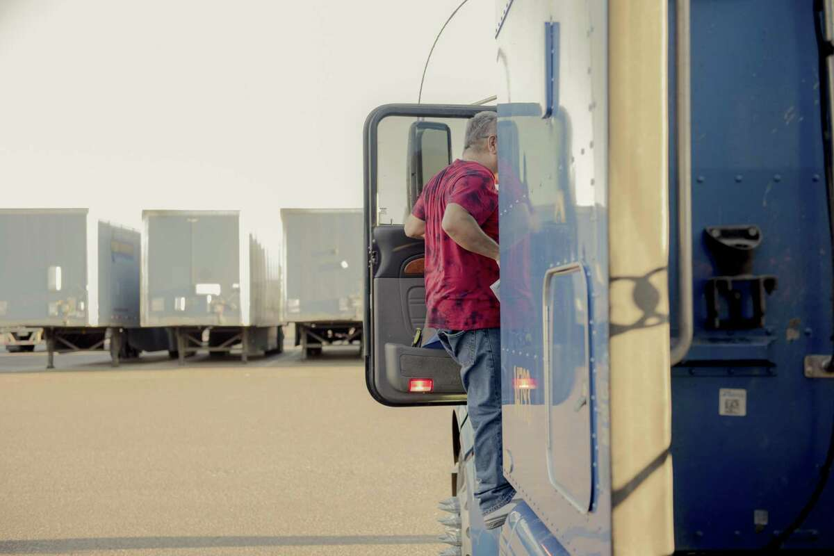 Carlos Flores readies his truck with a shipment of refrigerators that originated in Mexico at a Werner Enterprises lot in Laredo, Texas, Nov. 6. Undoing NAFTA will mean a lot of this kind of commerce could go away.