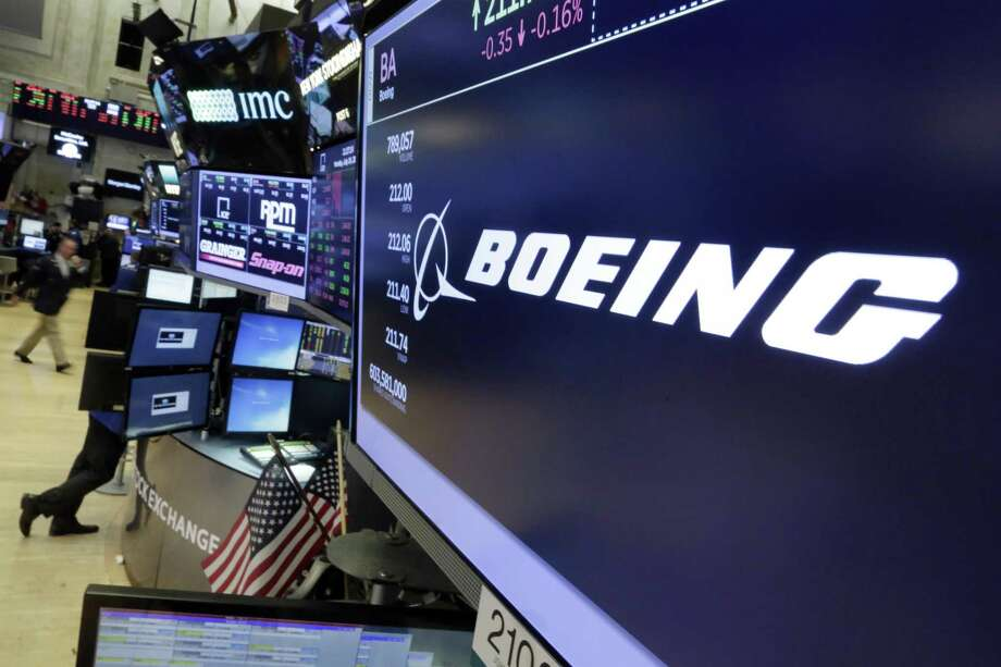FILE - In this July 24, 2017 file photo, the Boeing logo appears above a trading post on the floor of the New York Stock Exchange. Boeing Co. on Wednesday, Jan. 31, 2018, reported fourth-quarter profit of $3.13 billion. The Chicago-based company said it had net income of $5.18 per share. Earnings, adjusted for pretax gains, came to $4.80 per share. Photo: Richard Drew /Associated Press / AP