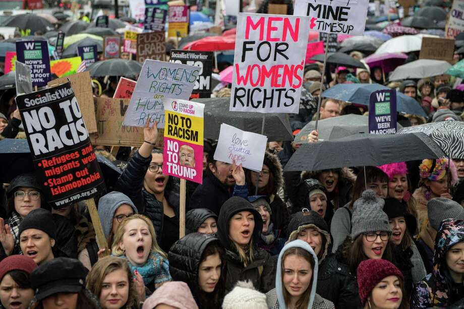 Women's rights demonstrators hold placards and chant slogans during the Time's Up rally Jan. 21 in London, England. This outcry on sexual harassment is needed, but fixing root causes — how boys treat girls — should also be a priority. Photo: Chris J Ratcliffe /Getty Images / 2018 Getty Images