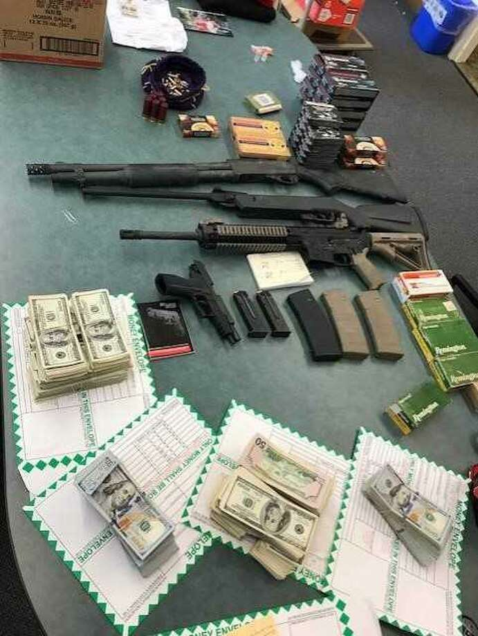 San Francisco police said a search of the home of Nicholas Adams, 25, turned up illegal narcotics and firearms, as well as approximately $275,000 in cash. Photo: Provided By San Francisco Police
