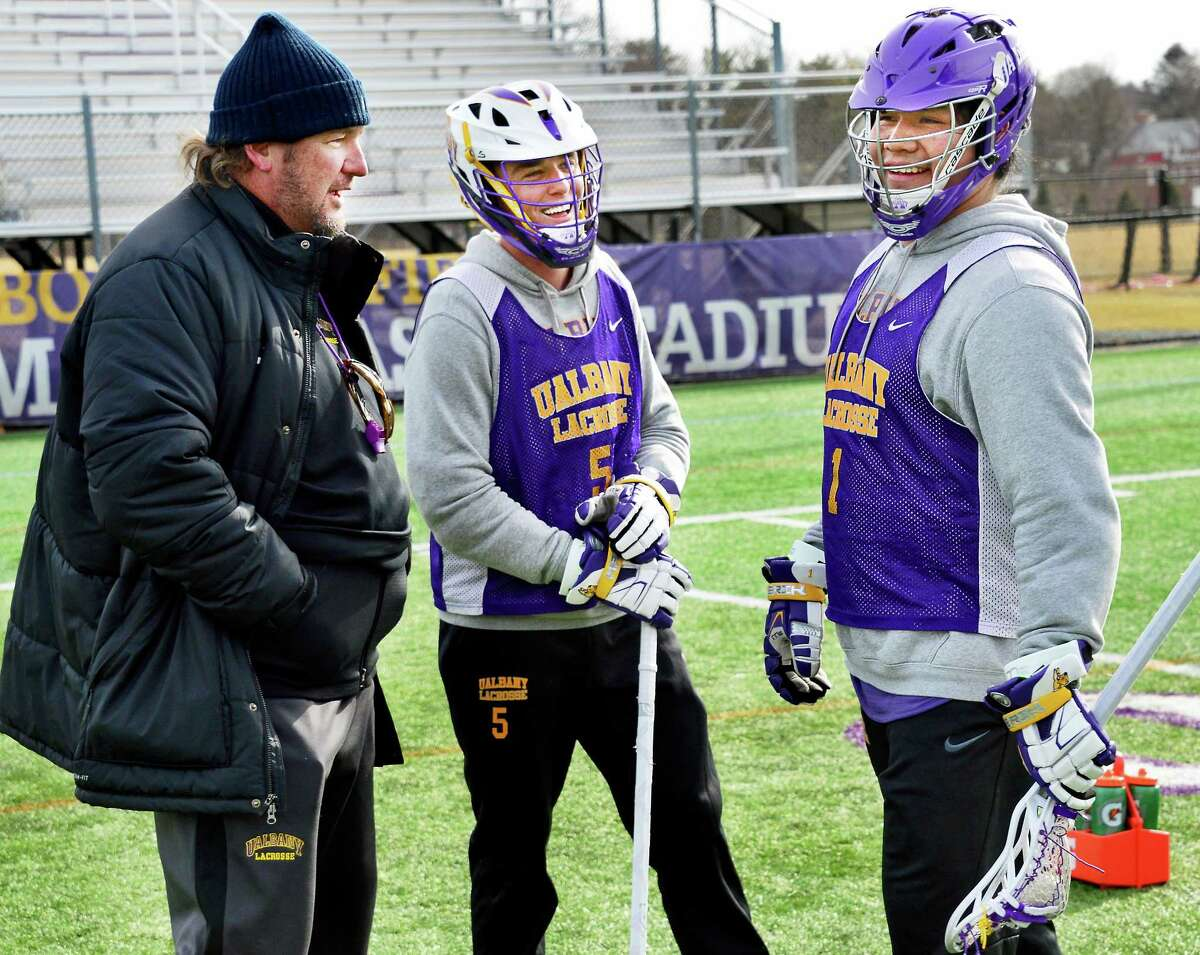 UAlbany lacrosse head coach Scott Marr with players #5 Connor Fields and #1 Tehoka Nanticoke, right, during practice Wednesday Jan. 31, 2018 in Albany, NY. (John Carl D'Annibale/Times Union)