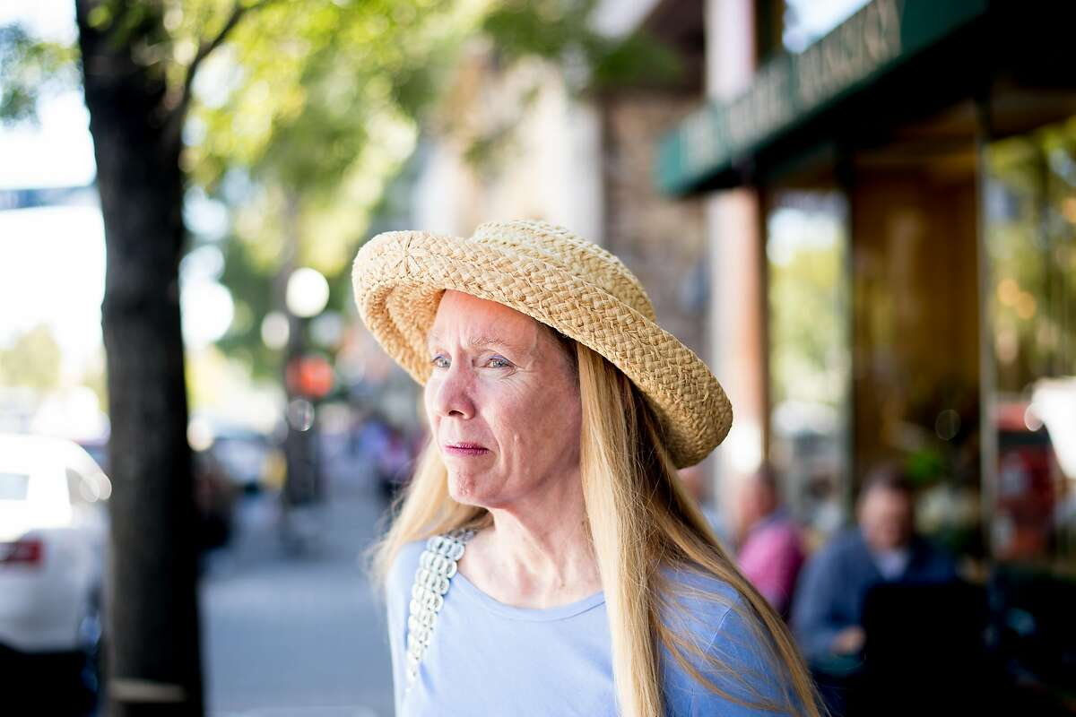 Kathy Coldiron, leading an effort to recall St. Helena's mayor, stand on Main St. in St. Helena, Calif., on Friday, Oct. 6, 2017.