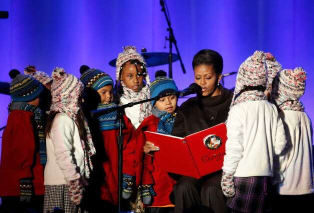 First lady Michelle Obama reads a holiday story to a group of children following the lighting of the National Christmas Tree, Thursday, Dec. 3, 2009, in Washington. (AP Photo/Haraz N. Ghanbari) Photo: Haraz N. Ghanbari / AP