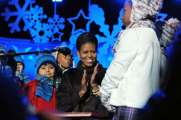 US First Lady Michelle Obama reads a Christmas story during the National Christmas Tree Lighting ceremony at the Ellipse, south of the White House, in Washington, DC, on December 3, 2009. AFP PHOTO/Jewel SAMAD (Photo credit should read JEWEL SAMAD/AFP/Getty Images) Photo: JEWEL SAMAD / AFP