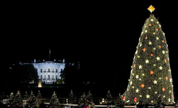 The White House is seen in the background after the lighting of the National Christmas Tree, Thursday, Dec. 3, 2009, in Washington. (AP Photo/Haraz N. Ghanbari) Photo: Haraz N. Ghanbari / AP