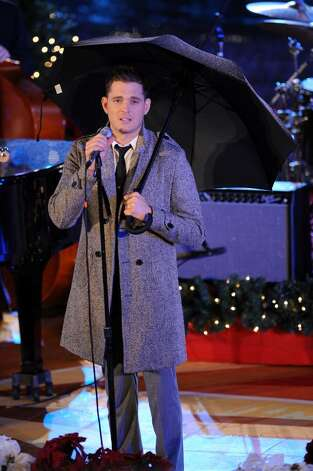 Singer Michael Buble performs onstage at the Rockefeller Center Christmas tree lighting at Rockefeller Center on December 2, 2009 in New York City.  (Photo by Bryan Bedder/Getty Images) Photo: Bryan Bedder / 2009 Getty Images