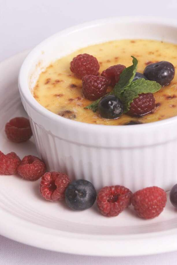 What to do with this season's raspberries? For starters, you can use them to make a fruity creme brulee. Add a few blueberries on top and sprinkle berries on the sides for an even sweeter look and taste. (Heather Wines/Gannett News Service) Photo: HEATHER WINES / GANNETT NEWS SERVICE
