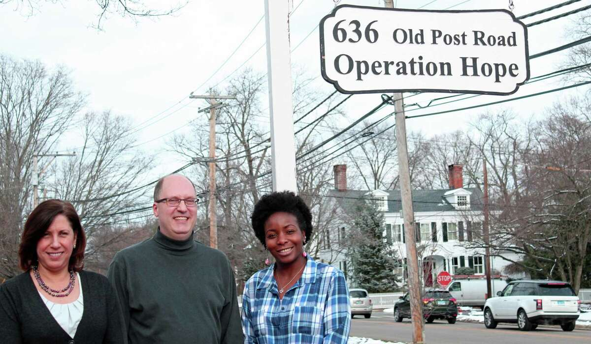 The temporary housing shelter run by Operation Hope will be closing, as the organization focuses on finding permanent housing for the homeless. From left, Operation Hope Executive Director Carla Miklos, board of directors member Robert Bellitto, Jr., and Nelcia Medley, a housing coordinator for Operation Hope. Fairfield,CT. 1/30/17