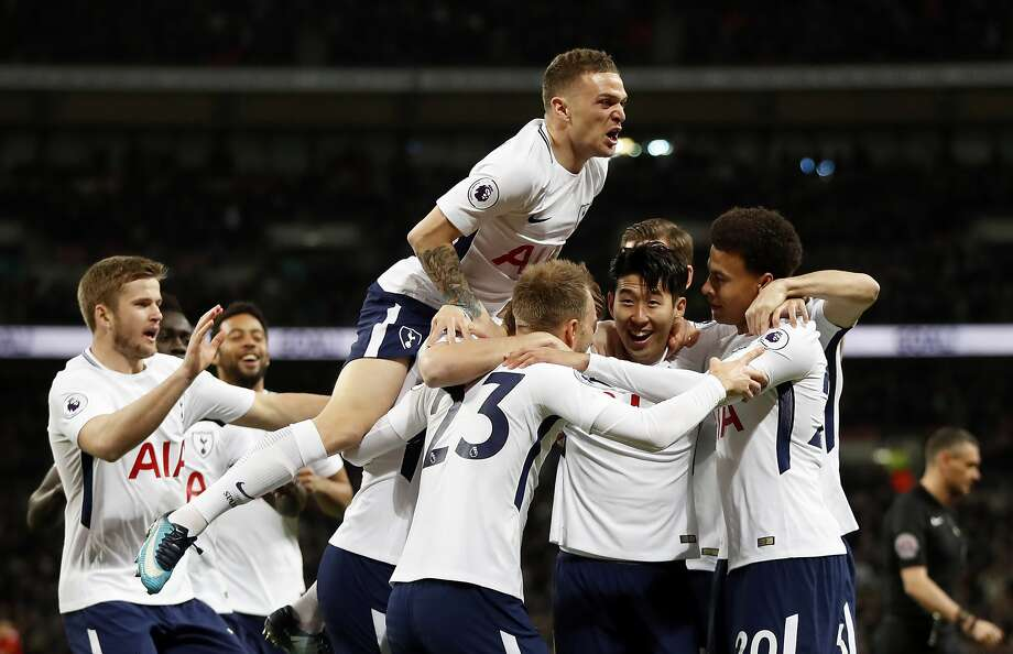 Tottenham's Christian Eriksen, center with back to camera, celebrates after scoring the opening goal during the English Premier League soccer match between Tottenham Hotspur and Manchester United at Wembley stadium in London, England, Wednesday, Jan. 31, 2018. (AP Photo/Kirsty Wigglesworth) Photo: Kirsty Wigglesworth, Associated Press