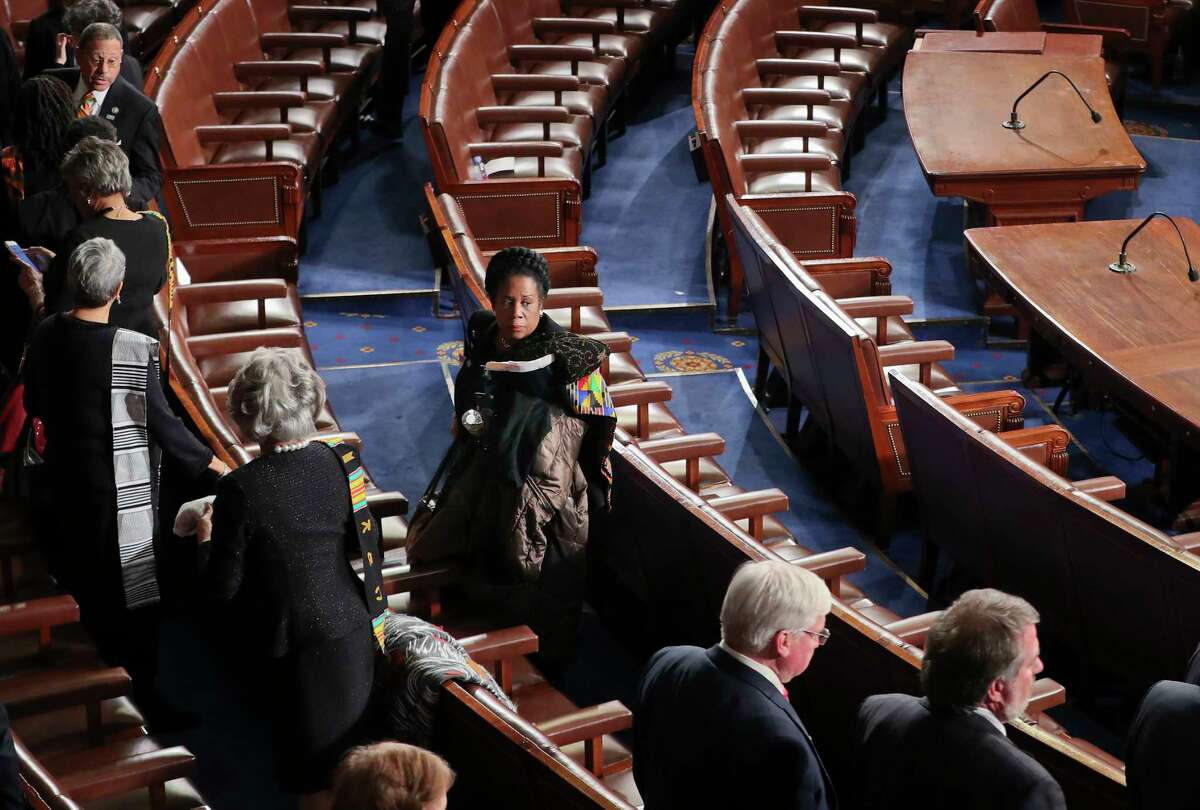 Rep. Sheila Jackson Lee, D-Texas, center, gathers her belongings and looks back over her shoulder after President Donald Trump's address to a joint session of Congress on Capitol Hill in Washington, Tuesday, Jan. 30, 2018. (AP Photo/Pablo Martinez Monsivais)