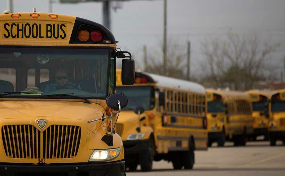 A Houston ISD bus driver leaves the HISD Northwest Shop on the 6300 block of Pinemont Drive as he headed out on a afternoon route Thursday, Jan. 8, 2015, in Houston. Hundreds of Houston ISD students had their school bus service interrupted Thursday morning after numerous bus drivers refused to drive their routes over a pay dispute. ( Johnny Hanson / Houston Chronicle ) Photo: Johnny Hanson, Staff / © 2015  Houston Chronicle