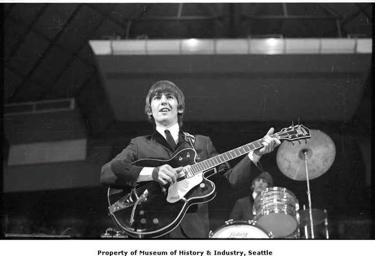 George Harrison playing guitar at the Beatles concert, Seattle Center Coliseum, August 21, 1964 Courtesy of MOHAI, Timothy Eagan Beatles Photographs, 2014.14.2_33