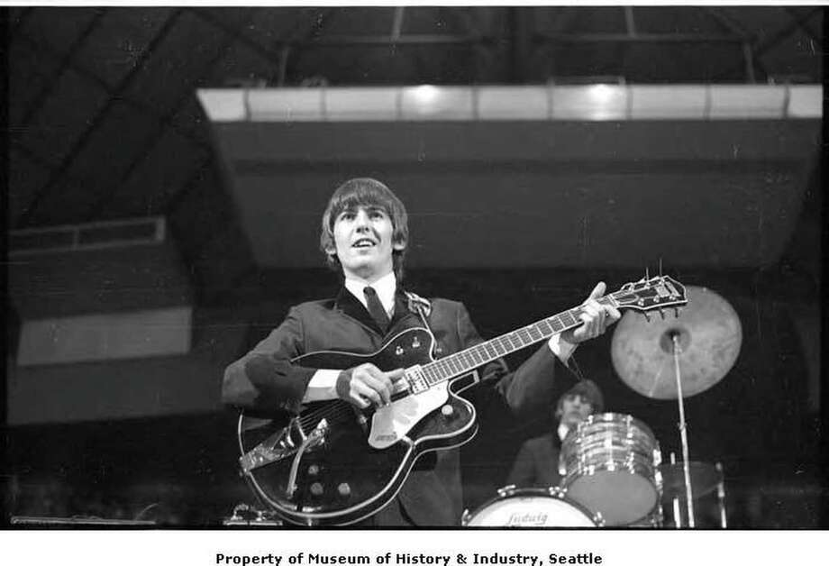 George Harrison playing guitar at the Beatles concert, Seattle Center Coliseum, August 21, 1964  Courtesy of MOHAI, Timothy Eagan Beatles Photographs, 2014.14.2_33 Photo: MOHAI, Timothy Eagan Beatles Photographs / Other