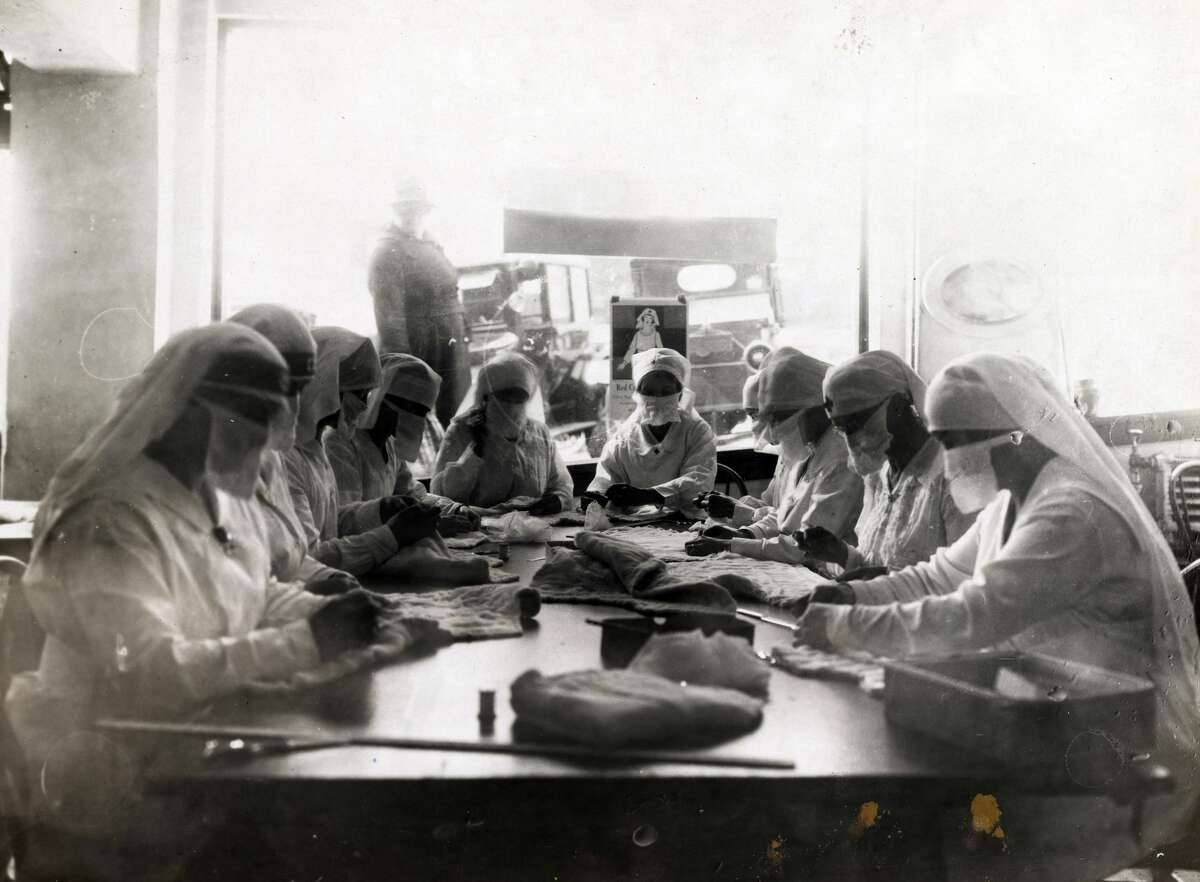 Nurses are pictured at work in Red Cross rooms in Seattle, with influenza masks. Pictured December 1918.Click through for a look at how Seattle, San Francisco and other American cities responded to the 1918 flu pandemic.