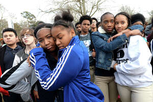 Eight graders, including India Crathin (far left) and Abria Bijou, console one aother as they get words of thanks from teacher Jamie Brown's mother Kristi Harvey following a balloon release in Brown's honor at Vincent Middle School Wednesday. Brown was killed in an automobile accident last Thursday. The driver in the single-vehicle crash, Thad Douglas, was also killed. Brown was a teacher at Vincent for 2 years and had nearly 200 7th and 8th grade students. Eighth graders gathered outside the school, each carrying a red balloon with a personal message attached. Brown's family attended the event, talking with and consoling her students following the balloon release. Photo taken Wednesday, January 31, 2018 Kim Brent/The Enterprise