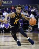 California's Don Coleman drives against Washington in the first half of an NCAA college basketball game Thursday, Jan. 11, 2018, in Seattle. (AP Photo/Elaine Thompson)