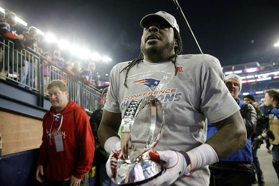 Former 49er Ricky Jean Francois, who held the AFC title trophy on Jan. 21, will play in his second Super Bowl. Photo: Winslow Townson, Associated Press