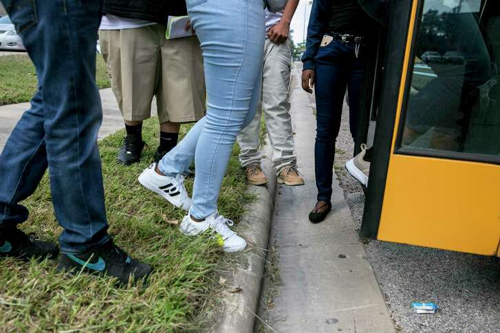 Students board a school bus in Houston on Sept. 11, 2017. For years, Texas education officials illegally led schools across the state to deny therapy, tutoring and counseling to tens of thousands of children with disabilities, the federal government said Jan. 11, 2018. (Ilana Panich-Linsman/The New York Times)