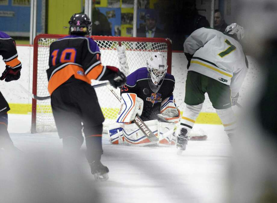Westhill-Stamford Co-op goalie John Kanaris (29) defends the net on a power play shot by Jack Kinahan (7) in the second period in a FCIAC boys hockey game at Terry Connors Rink in Stamford, Conn. on Wednesday, Jan. 31, 2018. Westhill-Stamford Co-op defeated Trinity Catholic 9-5. Photo: Matthew Brown / Hearst Connecticut Media / Stamford Advocate