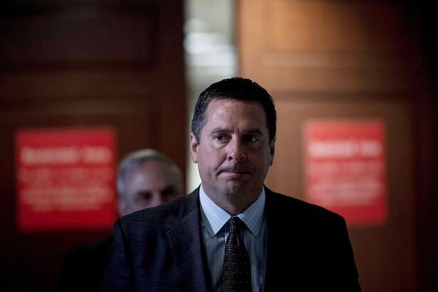 (FILES) This file photo taken on July 25, 2017 shows Rep. Devin Nunes (R-CA) leaving after Senior Advisor Jared Kushner meets with the House Intelligence Committee on Capitol Hill in Washington, DC. A secret Republican memo alleging that a politically motivated Department of Justice and the FBI flagrantly abused regulations to spy on the Trump campaign has gripped Washington just as the Russia meddling probe edges closer to the White House. Republicans are keen to see the four-page memo -- written by Republican lawmaker Devin Nunes, the chairman of the House Intelligence Committee and a close defender of President Donald Trump -- released, and his committee voted to do so.  / AFP PHOTO / Brendan SmialowskiBRENDAN SMIALOWSKI/AFP/Getty Images