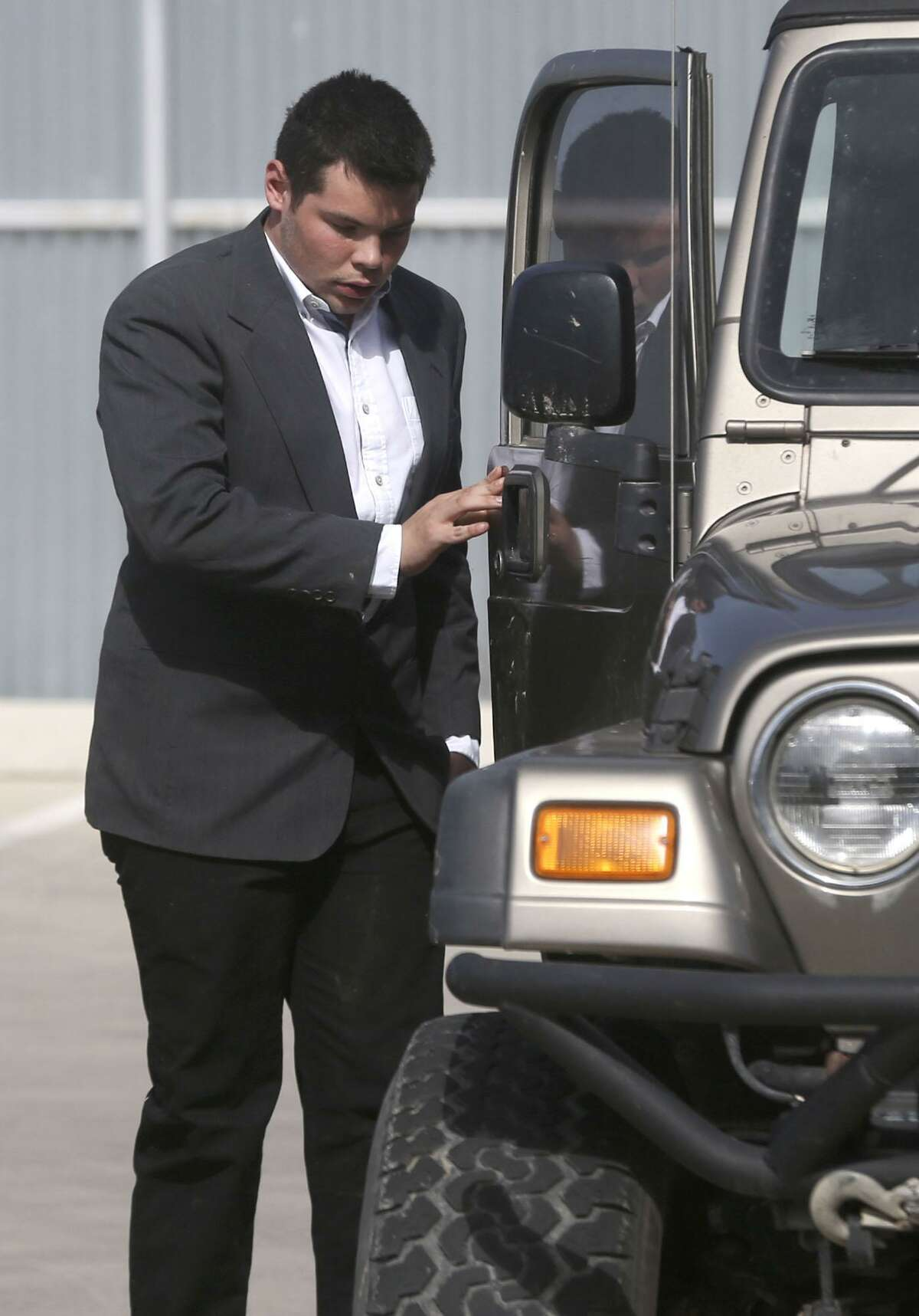 Jack Young gets out of a Jeep Wednesday January 31, 2018 at the Uvalde County Justice Center. Young was involved in a crash last year that killed 13 members of a New Braunfels church. Young was appearing in Uvalde for a hearing that was reset for May 31, 2018.