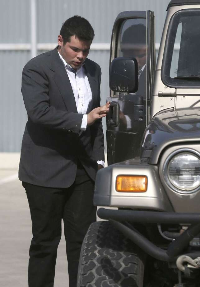 Jack Young gets out of a Jeep Wednesday January 31, 2018 at the Uvalde County Justice Center. Young was involved in a crash last year that killed 13 members of a New Braunfels church. Young was appearing in Uvalde for a hearing that was reset for May 31, 2018. Photo: John Davenport, STAFF / San Antonio Express-News / ©John Davenport/San Antonio Express-News