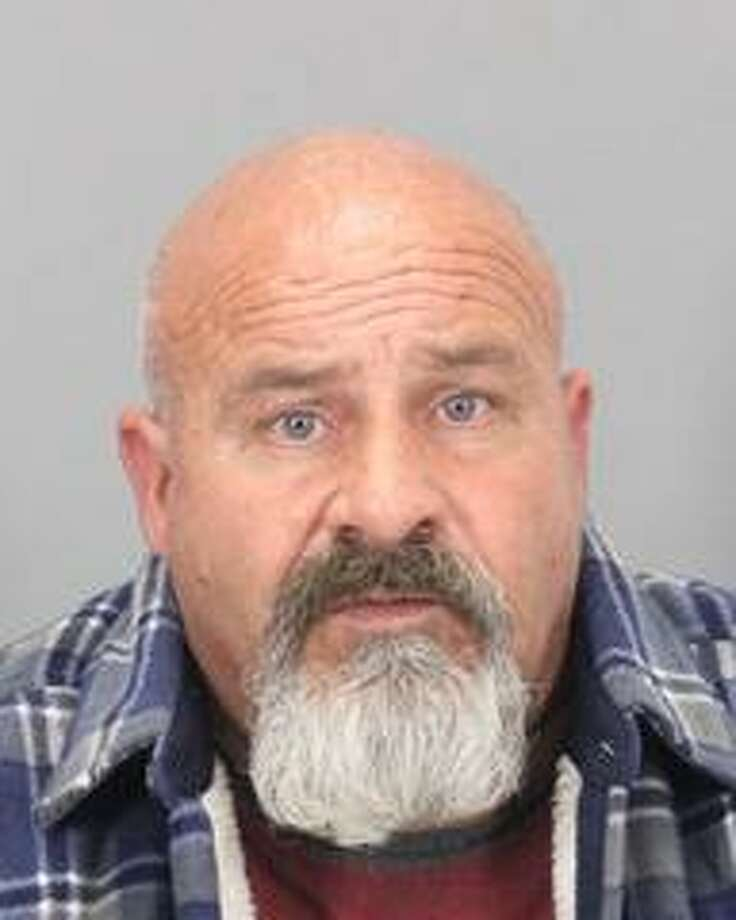A man was arrested on suspicion of sexual assault after he impersonated a police officer to a woman he arranged to meet and coerced her to have sex with him, police said.