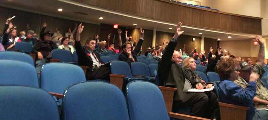 Central Texas residents raise their hands at a public hearing Jan. 31 in Fairfield to show opposition to a plan by Texas Central Partners to develop a 240-mile high-speed rail line between Houston and Dallas. Photo: Dug Begley / Houston Chronicle