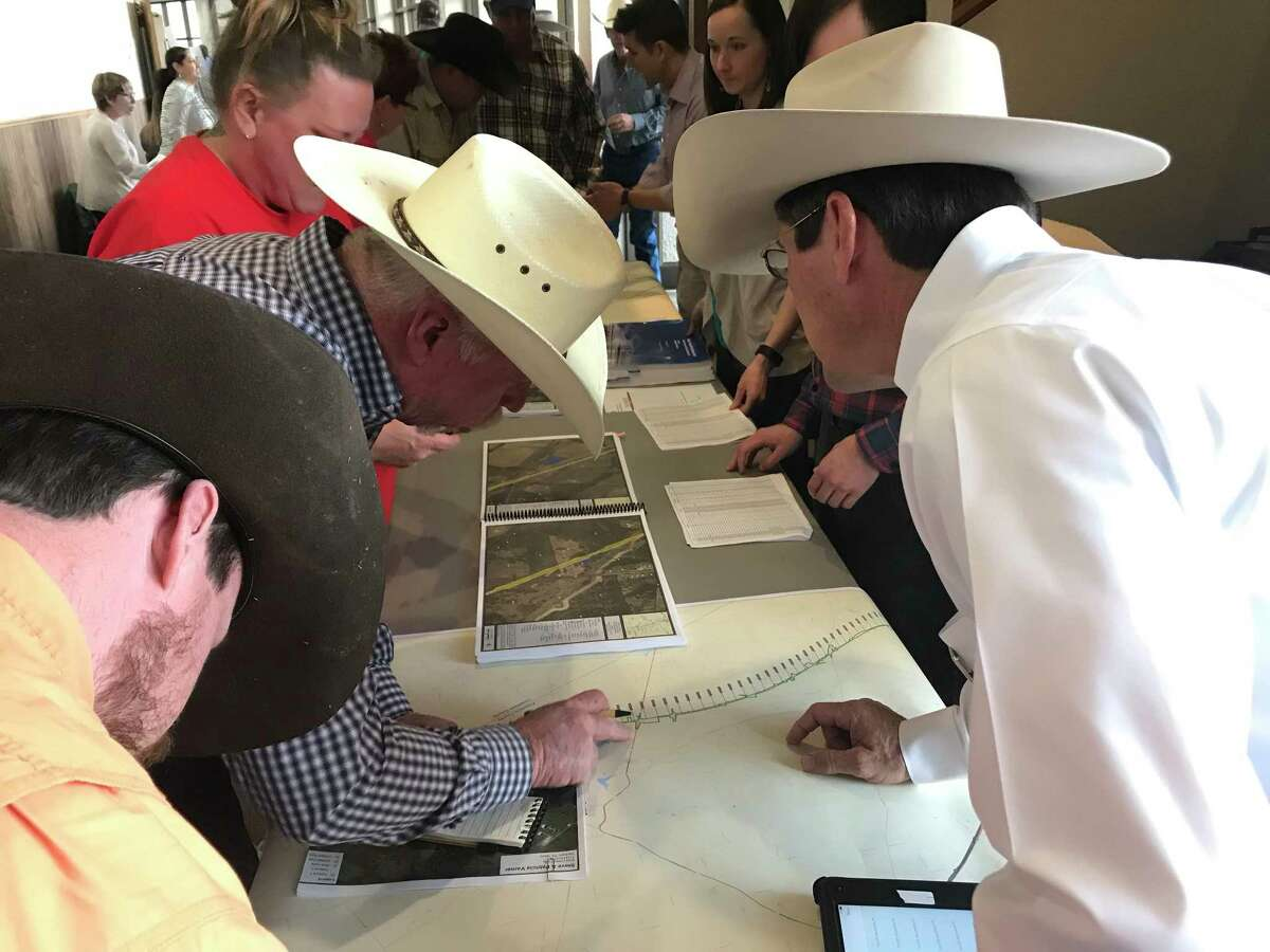 Concerned landowners look over specifics of the proposed route of a high-speed rail line by Texas Central Partners. at a public hearing Jan. 31 in Fairfield.