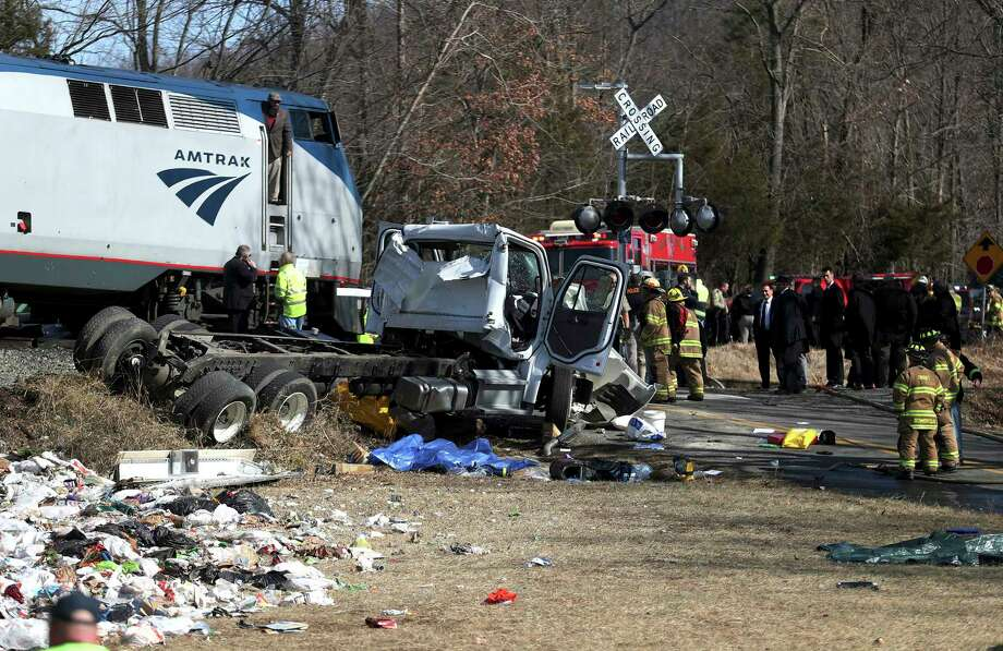 Emergency personnel work at the scene of a train crash involving a garbage truck in Crozet, Va., on Wednesday, Jan. 31, 2018. An Amtrak passenger train carrying dozens of GOP lawmakers to a Republican retreat in West Virginia struck a garbage truck south of Charlottesville, Va. No lawmakers were believed injured, but it at least one person in the truck was said to be seriously injured.  (Zack Wajsgrasu/The Daily Progress via AP) Photo: Zack Wajsgrasu, MBR / The Daily Progress